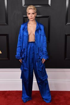 Wearing a TLC-inspired blue silk suit by Christian Wijnants and John Hardy jewels. Image Source: Getty / Jo...