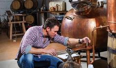 Scot Sanborn of Sutler's Spirits Co. monitors the temperature of his brew, tucked inside a building that's part of the once-gritty-now-trendy West End Mill Works district in Winston-Salem, NC. makes small-batch gin and rum, which ages in charred white oak Bourbon barrels — new and used — stacked along a wall near the distillery bar. Made with sugar cane syrup and molasses in a copper still crafted in Portugal, the rum will hit market when it's ready. Got to Be NC
