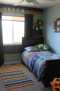 Caution Kid Zone!, This small space suits my son very well.  The room is all about fun, construcion, and things that move! , I painted striped on a wall to give the room a feature wall.  I love stripes, I think they make a room fun!, Boys' Rooms Design