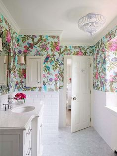 10 Modern Ways to Decorate with Granny Florals | Bright floral wallpaper in a sleek white bathroom. @stylecaster