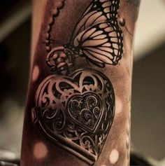Photo Realism Tattoo - Heart Locket Butterfly ---- I love the realistic look on this, and want it as a reference for my upcoming tattoo!