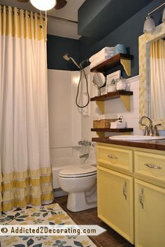 I have the same blue in my bathroom-but I never thought yellow would look so good with it, I'll have to try this!