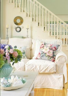 "White slipcovers are the easiest thing to have on furniture with children & pets -- just throw them in the washer (and bleach gets rid of most stains). ""Overstuffed sofas make friends visit longer!"""
