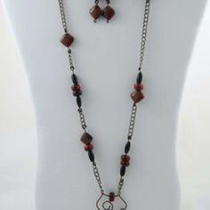 Red/black Jasper petroglyph stone hand-shaped and polished, red tiger eye and hand dyed red crow beads
