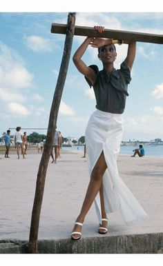 Beverly Johnson, Vogue December 1973. Saint Laurent´s Rive Gauche little shirt-top in black-and-white silk dots with a long button-front white skirt. Hair and make-up Rick Gillette with Clinique cosmetics. Location: Salvador de Bahía-Brazil. Photo by Kourken Pakchanian