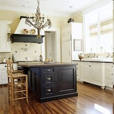 White kitchen cabinets with black island
