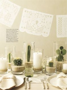 cactus and sand in cylinder vases and candles in hurricanes as centerpieces | martha stewart living