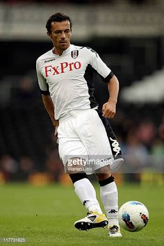 Simon Davies of Fulham in action during the UEFA Europa League qualifying match between Fulham and NSI Runavik at Craven Cottage on June 30 2011 in...
