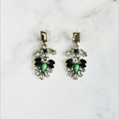 NEW Green gorgeous chandelier earrings We've all seen these everywhere, but sometimes the most basic accessories can only shine when worn by a true Kween honey, yassss!!!! These are brand new, never worn // green beads highlight this art deco inspired black and crystal cluster // brassy antiqued gold tone base/frame // nice weight to these earrings, but they do not pull or weigh your ear down // more pics coming soon on ear //current price is firm // please do not repost photos, as they'll…