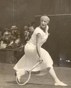 Mlle Suzanne Lenglen looks the picture of elegance in action at Wimbledon In 1924.