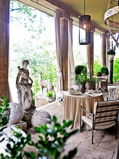Designer Barry Dixon's loggia has sweeping views and classical appointments.
