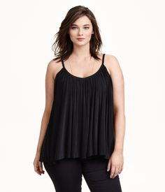 Flared camisole top in jersey with a slight sheen. V-neck, gathers at neckline, and narrow shoulder straps. Lined.