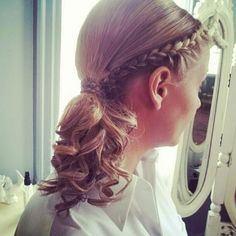 french braid into curly ponytail