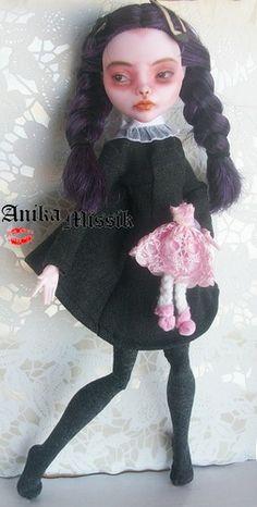 by Anika Missik (looks like Wednesday Addams)