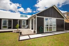 board and batten cladding with ply looks very cool also can be used on inverted 'V' like our house love the windows and love the deck Cladding Design, House Cladding, Metal Cladding, Exterior Cladding, Board And Batten Cladding, Board And Batten Exterior, Style At Home, Roof Styles, House Styles