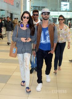 Shahid Kapoor and Shraddha Kapoor seen at the Mumbai Domestic Airport returning from Bangalore where they had gone to promote their movie 'Haider'.