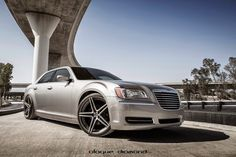 The Chrysler 300 is one of those under-the-radar full-size luxury cars that is distinctly American. It's clean Avant-Garde design and characteristic chrome applications make it at home on the swank city streets at night. Of course, part of that American DNA involves some classic V-8, rear-wheel drive power that puts a smile on your face. This Chrysler 300C with Blaque Diamond Wheels makes a statement in more ways than one from its stunning fitment to its powerful engine. #Chrysler #Wheels