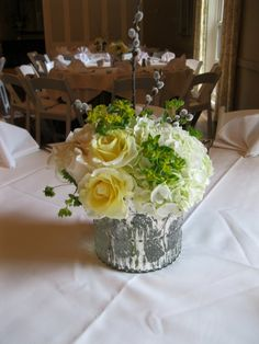 50th wedding anniversary dinner centerpieces with mercury glass containers
