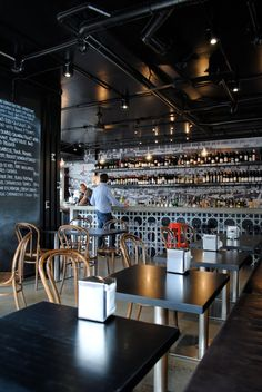 love the print underneath the bar  chalkboard paint on walls. Great linear line for display