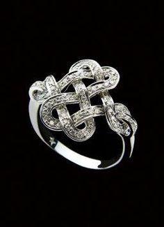 aa99b9375 H.Stern Diane von Furstenberg Love Knot Ring in 18K white gold with  diamonds at
