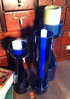 Repurposed wine bottles. Eco friendly candle holders or set of vases. Sapphire jewel blue glass..