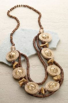 Celestial-inspired jute discs surround gleaming silver beads on this original, asymmetrical handcrafted necklace accented with wood beads and shells. Sun Coast Necklace #64399