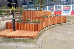 These planters for Colmore Business District were designed around our popular Tree planter design and were so large they had to be manufactured in sections that could be bolted together on site. Factory furniture also provided the concrete plinth for the feature seat, the concrete retaining wall and the concrete furniture for chess garden. The material: honed limestone effect concrete, FSC® timber and stainless steel…