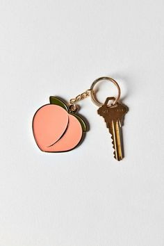 Feeling peachy keen with this sweet little keychain handmade in NYC by VERAMEAT. Peach-shaped charm with sleek metal edging + colorful enamel filling complete with a chain link + key ring. Style Urban, Peach Aesthetic, Things To Buy, Stuff To Buy, Just Peachy, Gal Pal, Pin And Patches, Urban Outfits, 20s Outfits
