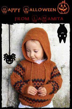 Maglione ai ferri per bambini con cappuccio e disegno etnico. Comodo e pratico questo splendido maglione di lana per bambini