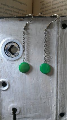 Check out this item in my Etsy shop https://www.etsy.com/listing/104090196/green-mother-of-pearl-dangle-earrings
