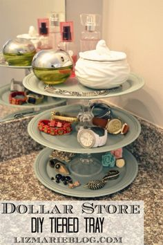 DIY dollar store tiered tray for the bathroom... can be used in any room for organization & all items are found at the dollar store!