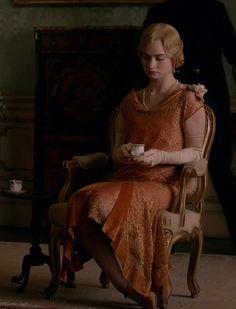 Lady Rose's elegant orange evening gown.