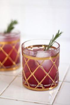 A merry Rosemary + Cranberry cocktail.... the drink sounds great, but I love the glasses.