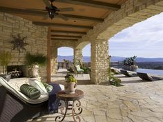 Outdoor fireplaces are a great feature for chilly evenings, and old-fashioned ceiling fans do the trick when outside temperatures soar. Designed by Lori Dennis.  http://www.hgtv.com/landscaping/outdoor-rooms-for-any-budget/pictures/page-10.html?soc=pinterest