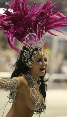 A reveler from the Dragoes da Real Samba School takes part in the carnival at Anhembi Sambadrome in Sao Paulo.