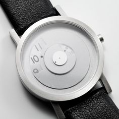 With Reveal, time is always in the present. This timekeeper reveals the current time through a looking glass while fading the past and the future. If you are a person of the present, this watch is made specifically for you. STEEL Reveal has a brushed stainless steel case with matching dial and hands giving it the perfect monochromatic look! With black leather band: our smooth black leather band, Reveal has an elegant look for a night out on the town or for everyday use.
