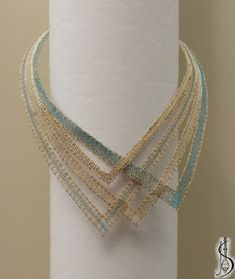 Necklace No. 10443c Blue and beige silk, golden metallic yarn. ............................ Protected by copyright! Price: € 65