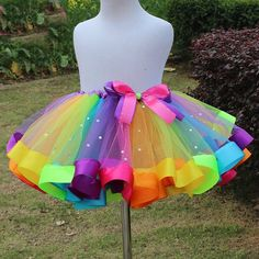 Rainbow Kisses Tutu Dress. Let the party begin in this adorable Rainbow Kisses Tutu Dress! This adorable tutu dress features an elastic waist with all the colors of the rainbow, a ribbon edge and shimmery rhinestones placed throughout the skirt so your princess is sure to shine! Sizing: 6 Months - 10 Youth TheChicFind.com