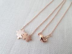 This adorable puzzle piece. | 18 Rose Gold Necklaces That Will Take Your Breath Away