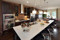 This model home kitchen is sweetly sophisticated for a downtown feel in the suburbs of DC!  Miller & Smith, via Flickr.