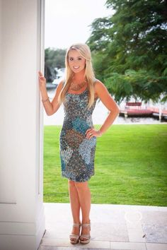 Turquoise and Beige Dress 62.00 Turquoise and Beige Sleeveless Dress with a Touch of Sparkle. Polyester/Spandex