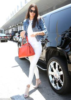 Striking in white: Kendall Jenner put on a very leggy display in tight white jeans and pee...