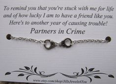 This is a partners in crime bracelet with antiqued silver plated handcuff charms, silver plated chain, and lobster claw clasp. This comes with a