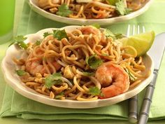 Pad Thai is Thailand's most well known noodle dish, which you'll find on almost all Thai restaurant menus in America.  A trip down the Asian-foods aisle in the supermarket should lead you to its traditional ingredients, such as rice noodles and fish sauce.
