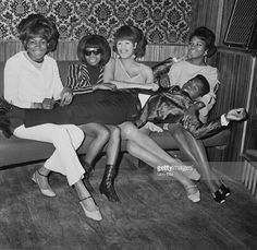 Prince Buster relaxes with a few fans...