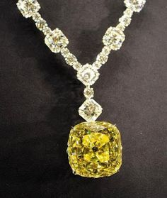 'The Tiffany (128.54 Carat Canary Yellow) Diamond' -  In 1877, Tiffany & Co.'s iconic   diamond was found in South Africa. It was later set in a diamond necklace.  Over a year in the making, the elegant necklace of white diamonds totals over 100 carats and features 20 Lucida® diamonds and 58 brilliant-cut diamonds. The Diamond's mounting, an openwork motif of sunrays, is designed with 481 sparkling stones.Today, it's on permanent display in Tiffany's New York Fifth Avenue flagship store.
