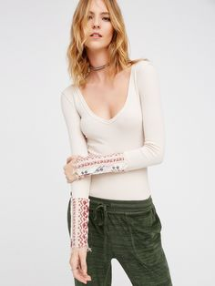 Art School Cuff Top | Long sleeve tee with a lived-in look and a relaxed feel. Features uniquely printed bohemian sleeve cuffs with decorative buttons. V-neckline and easy, rounded hem. So comfy and stretchy fabrication.