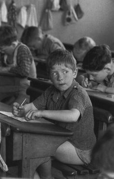 """""""Should I cheat?"""" Making sure no one is looking....elementary school,1956...photo by Robert Doisneau"""