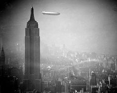 The zeppelin Hindenburg floats past the Empire State Building over Manhattan on Aug. The German airship was en route to Lakehurst, New Jersey, from Germany. The Hindenburg would later explode in a spectacular fireball above Lakehurst on May (AP Photo) Zeppelin, Empire State Building, Old Pictures, Old Photos, Retro Pictures, Rare Historical Photos, Vintage Photography, City Photography, Belle Photo