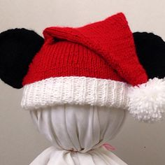 This is a knit-in-the-round hat inspired by Mickey Mouse and Santa. It is made using worsted weight yarn and incorporates slipped stitches and picking up stitches to add ears without having to sew them on.